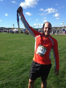 Mike and his finishing medal at the SONO Half Marathon